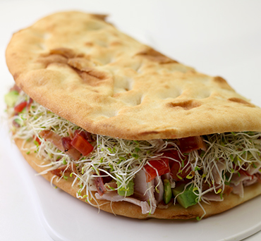 Naan Bacon, Turkey, and Sprouts Sandwich